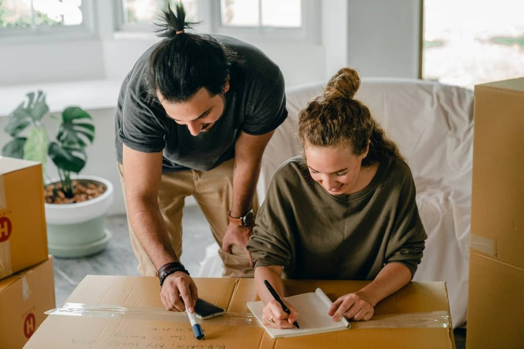 A couple making a New home checklist
