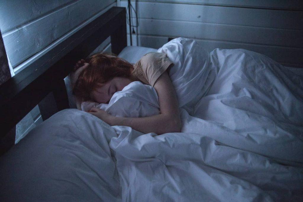 woman sleeping in a sleep friendly bedroom
