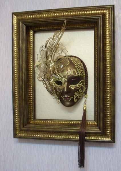Framed mask on the wall