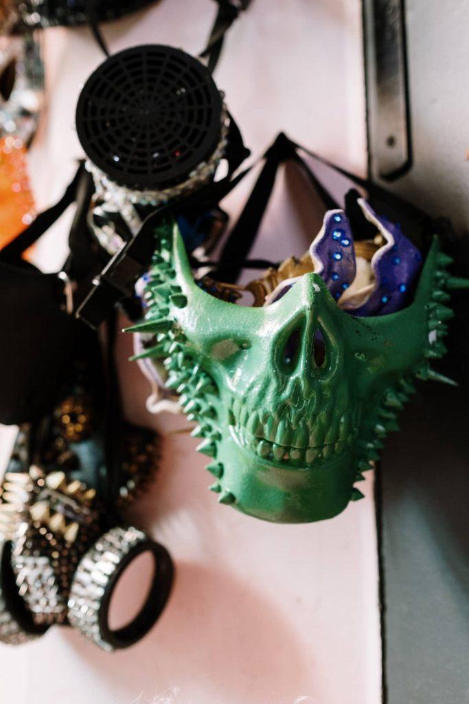 masquerade mask hanging on wall