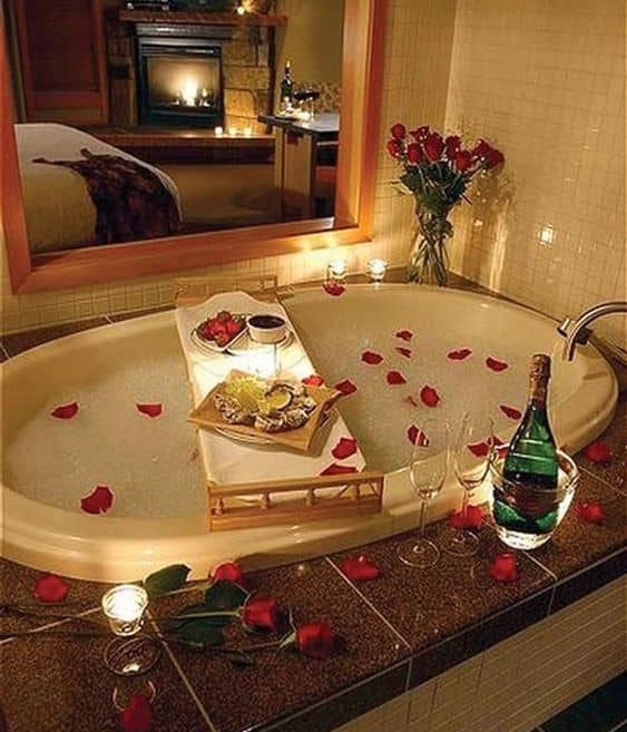 Passionate Floral Bathtub Decoration with roses candles lights and wine