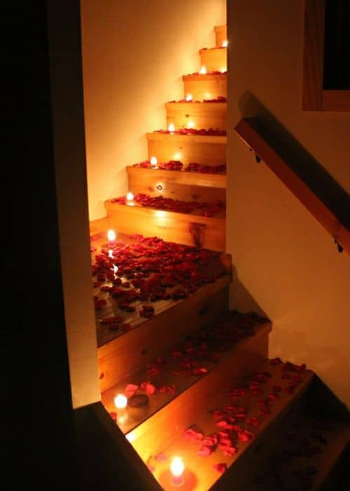 Romantic staircase decoration with flowers and candles