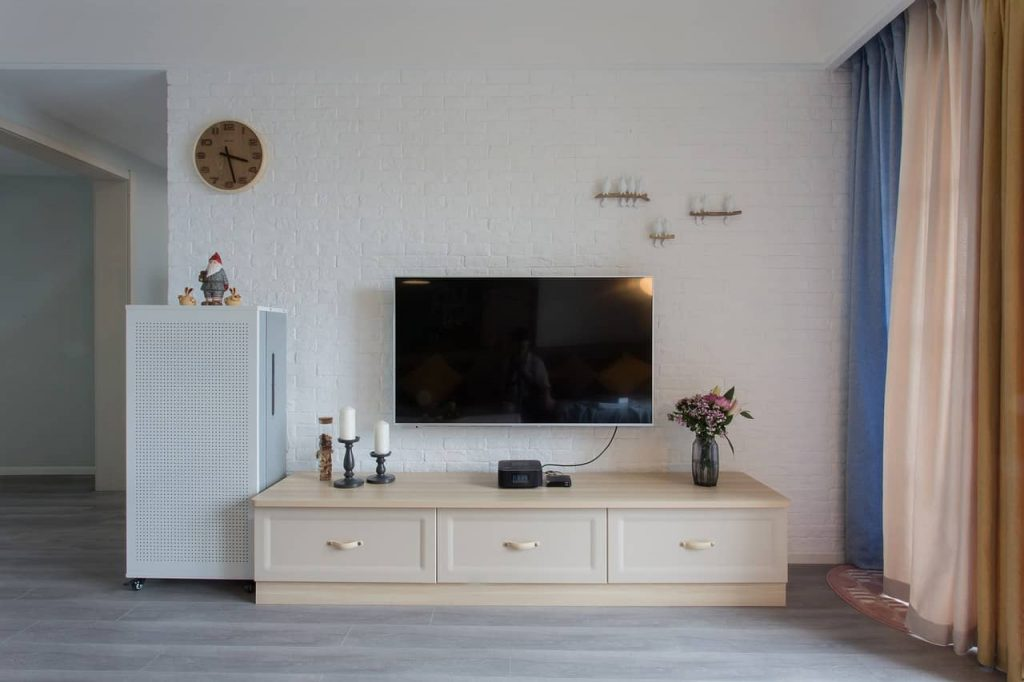 living room wall with tv on the wall decorated